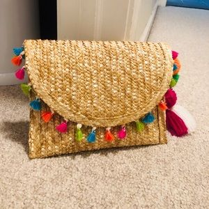 Clutch with tassels
